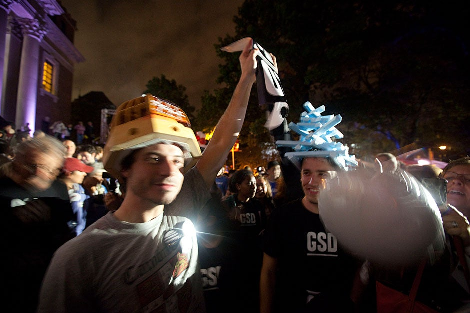 R. Taylor Dover (blue hat) and Trey Kirk (cone hat), both Harvard Graduate School of Design students, join the parade. Kris Snibbe/Harvard Staff Photographer