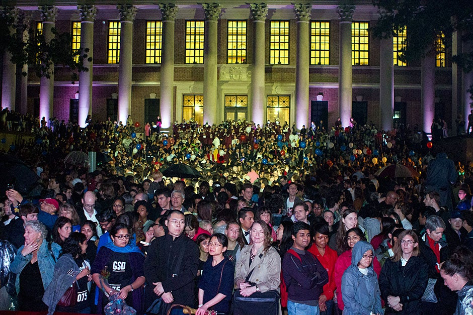 Rain-soaked crowds gather in front of Memorial Church in Tercentenary Theatre. Meghan Dhaliwal/Harvard Staff Photographer