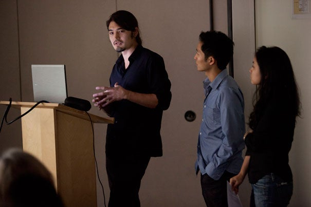 """During a student lecture at the Harvard Graduate School of Design, Sky Milner (left), Stephen Fan, and Yuhka Miura spoke of the summer months they spent in northeastern Japan. The constraints of time were undeniable as all three students were disappointed at having to leave after just a summer. But Fan was hopeful that students, even two months at a time, can make a difference. """"This is always seen as the start of a much larger commitment,"""" he said."""