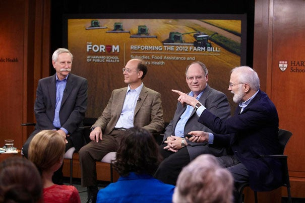 """""""If we judge by its impact on human health, the American food supply is a disaster,"""" said Walter Willett (left), chair of the HSPH Department of Nutrition. Willett was joined by Harvard Medical School Professor David Ludwig, Gary Williams of Texas A&M University, and Barry Popkin of the University of North Carolina."""