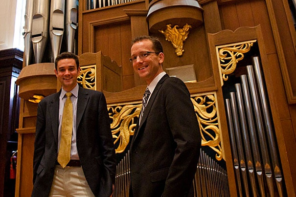 Assistant University Organist and Choirmaster Christian Lane (right) stands by the Fisk Organ in Appleton Chapel with Edward E. Jones, Gund University Organist and Choirmaster in the Memorial Church. Lane was recently named the winner of the prestigious 2011 triennial Canadian International Organ Competition.