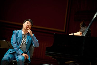 """Twenty-nine year old Lang Lang, hailed by The New York Times as """"the hottest artist on the classical music planet,"""" presided over a master class featuring three Harvard undergraduate players."""