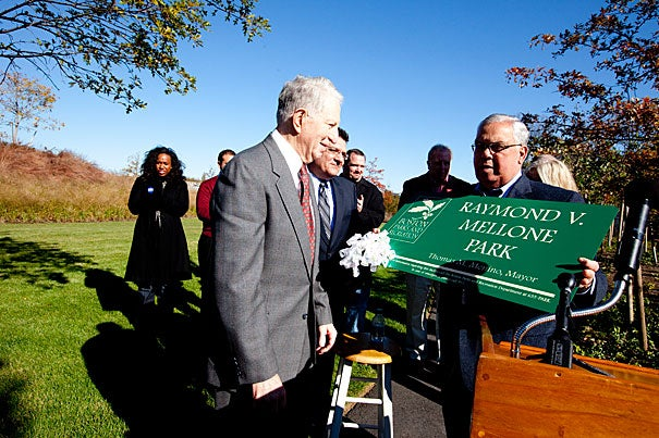 "The Honan-Allston Branch Library was renamed Raymond V. Mellone Park at an event hosted by Boston Mayor Thomas M. Menino (right). ""I don't think I'm the only one who ever did anything for the community; unfortunately there are not more parks to dedicate to individuals,"" Mellon said (left). The park, which opened in July, was built by Harvard on 1.74 acres of vacant land."