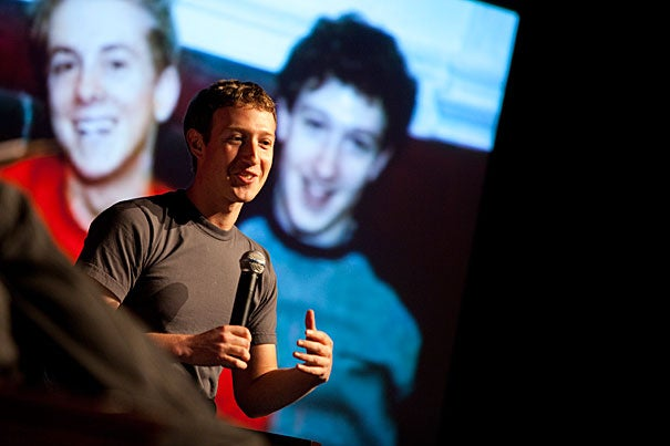 Mark Zuckerberg, with an image of a much younger Zuckerberg on the screen behind him, met with students in Farkas Hall to scout potential Facebook recruits.