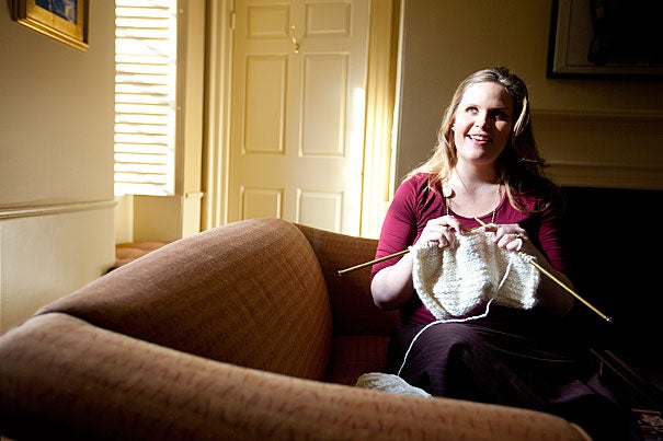 Marie Dach, executive assistant to the provost and a resident tutor in Pforzheimer House, leads a weekly knitting circle, and its proceeds benefit local homeless and women's shelters.