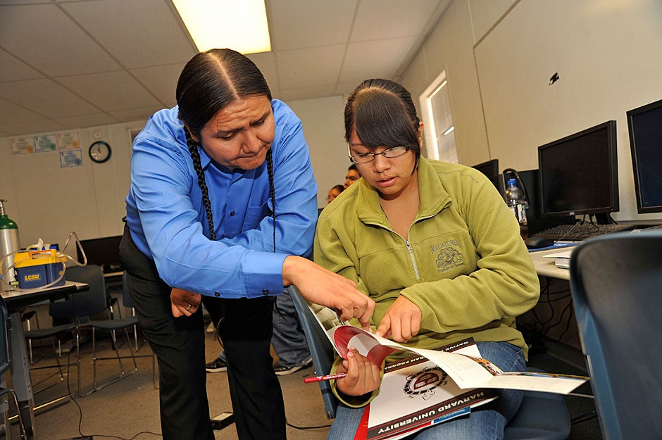 Harvard University Native American Program (HUNAP) Community Coordinator Jason Packineau assists a student at Walatowa Charter High School, Jemez Pueblo. Jon Chase/Harvard Staff Photographer