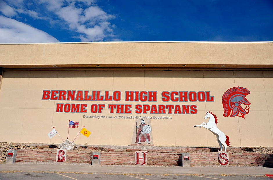 A wall mural at Bernalillo High School, which has a high proportion of Native American students, overlooks the parking lot. Bernalillo is a short drive from Albuquerque. Jon Chase/Harvard Staff Photographer