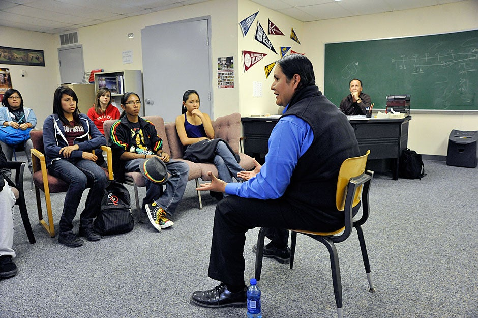 After briefly describing Harvard College to students at Bernalillo High School, Packineau speaks about the difficulty that native people have in leaving home, as he tries to prepare them for a possible giant leap from New Mexico to Cambridge or some other distant university destination. Jon Chase/Harvard Staff Photographer
