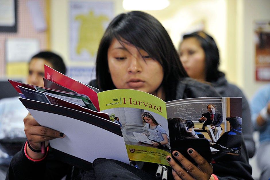 A Native American student at Bernalillo High School looks over a Harvard brochure. The fact that Harvard waives tuition entirely for families earning less than $65,000 makes it a more viable option than the University of New Mexico or even a local tribal college for low-income families. Jon Chase/Harvard Staff Photographer