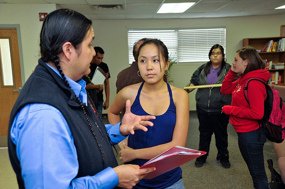 Jason Packineau speaks with a particularly motivated Bernalillo student who has brought her transcript for him to assess. Two students from Bernalillo have previously attended Harvard. Jon Chase/Harvard Staff Photographer