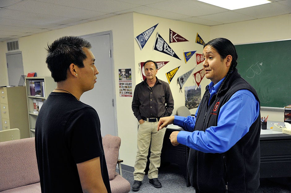 Jason Packineau speaks with a student at Bernalillo High School, as Native American student counselor Tom Williams looks on. Williams is hopeful that one of his students, either this year or next, will be accepted at Harvard. Jon Chase/Harvard Staff Photographer