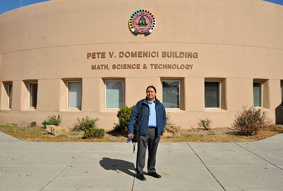 Jason Packineau stands in front of the central building at the Santa Fe Indian School. The building is named for Pete Domenici, the longest-serving U.S. senator in New Mexico's history. Jon Chase/Harvard Staff Photographer