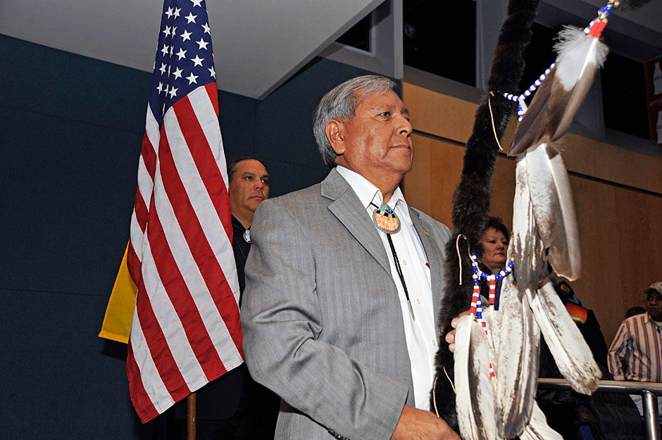 Walter Dasheno, governor of Santa Clara Pueblo, leads the opening ceremonies at the National Indian Education Association convention. Jon Chase/Harvard Staff Photographer