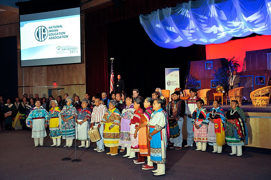 Singers and dancers perform in traditional formal clothing at the opening ceremonies of the National Indian Education Association (NIEA) conference. Jon Chase/Harvard Staff Photographer