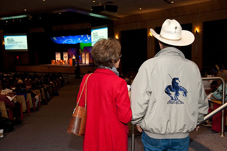 A couple listens to a speaker on stage at the National Indian Education Association conference in Albuquerque. Jon Chase/Harvard Staff Photographer