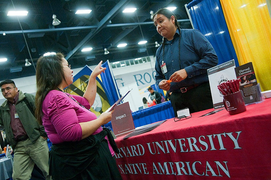 Jason Packineau mans the HUNAP booth at the National Indian Education Association conference. Jon Chase/Harvard Staff Photographer