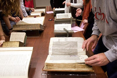"Students pore over old texts in the Gen Ed class ""Introduction to the Bible."""