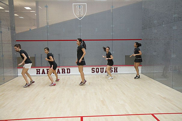"""The men's and women's squash teams are as yet undefeated, winning their last nine and seven matches, respectively. """"We've been training really hard,"""" said women's co-captain Nirasha Guruge (far right)."""
