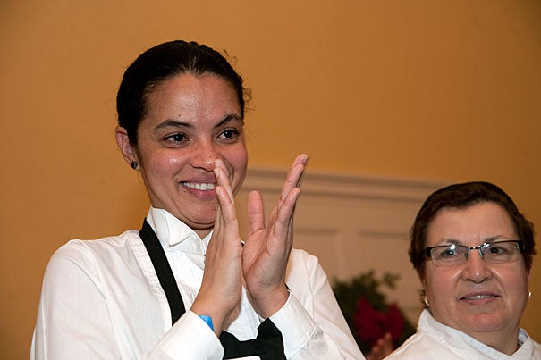 Kitchen staff Liliana Lopes (left) smiles through her tears as she and Filomena Costa react to applause after receiving gifts and acknowledgement for their contributions to the quality of life at Lowell House.