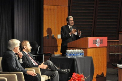 "A two-day conference titled ""AIDS@30: Engaging to End the Epidemic,"" which drew hundreds to the Joseph B. Martin Conference Center, worked to engage those who know the ailment best to plot its end. The Dec. 1 discussion brought together Harvard School of Public Health Dean Julio Frenk (right), Harvard Provost Alan Garber (center) and Richard Marlink (left), the program chair and Beal Professor of the Practice of Public Health."