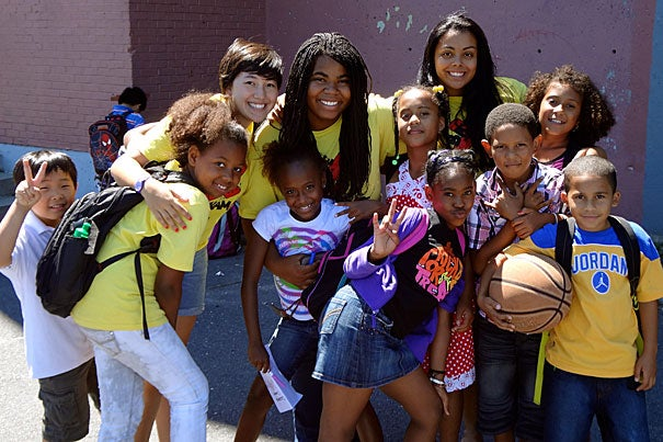 Harvard junior Carolyn Chou (second from left in group)  with campers and counselors from the Phillips Brooks House Association's Boston Refugee Youth Enrichment Program.