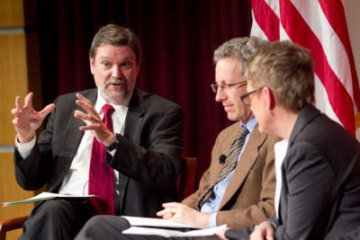 """Harvard Kennedy School Dean David T. Ellwood (left) moderated a panel discussion at the Kennedy School Forum titled discuss """"The Growing Challenge of Inequality."""" Among the participants was professors Lawrence F. Katz (center) and Kathy Edin."""