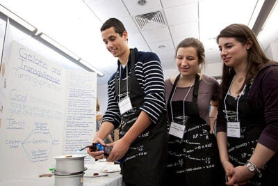 Gashaw Clark '14 (from left), K. Lanier Walker '14, and Rebecca Ruskin '13 prove that their jellied meat stock is stable enough to withstand direct flame without melting.