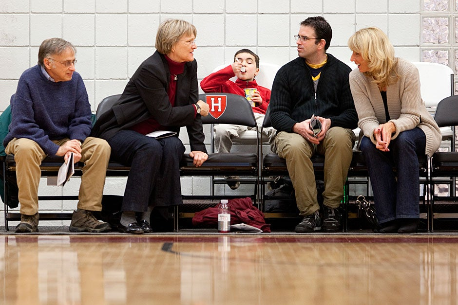 Harvard President Drew Faust was at the game, which was Harvard's second sellout of the season. She and husband Charles Rosenberg (far left) sat in new courtside seats that were added along with a new press box, both built to accommodate the growing interest in the program.  Rose Lincoln/ Harvard Staff Photographer