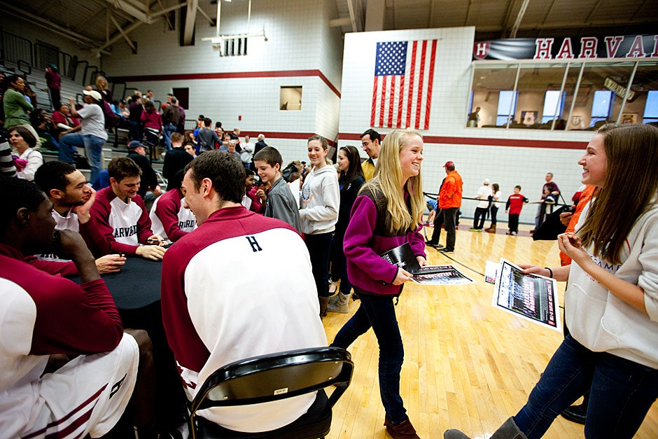 After the game, players convened to autograph photos for fans.    Rose Lincoln/ Harvard Staff Photographer