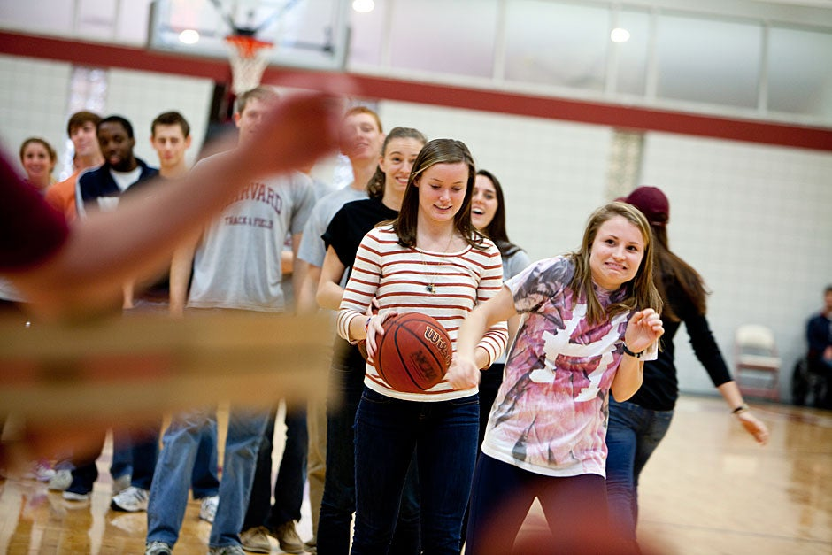 During halftime, Harvard students like Alaina Murphy (center) shot from the foul line in hopes of winning a free pizza. She missed.  Rose Lincoln/ Harvard Staff Photographer