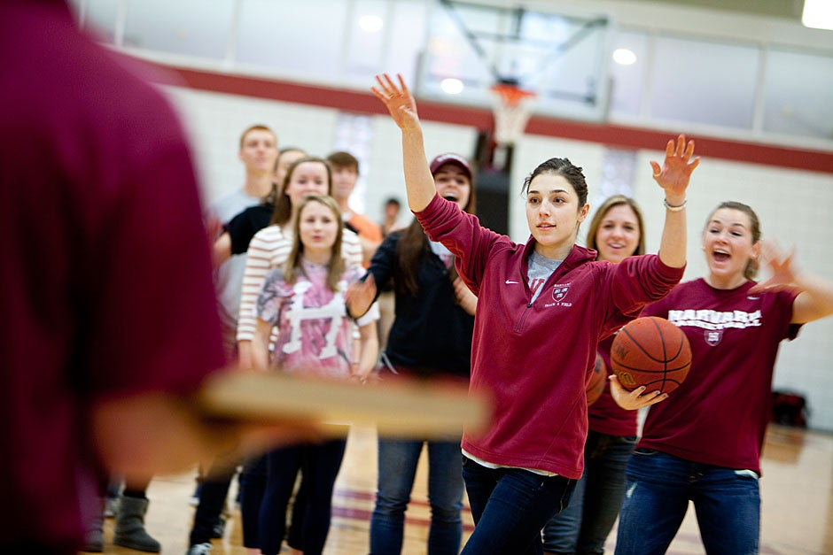 Another fan, Nicole Sliva, sunk the basketball and won the pizza. Celebrating behind her is Magda Robak.  Rose Lincoln/ Harvard Staff Photographer