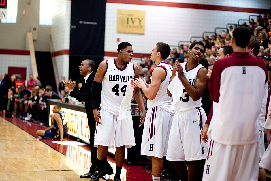 Whoop, there it is! The team gets pumped as the game heats up.  Rose Lincoln/ Harvard Staff Photographer