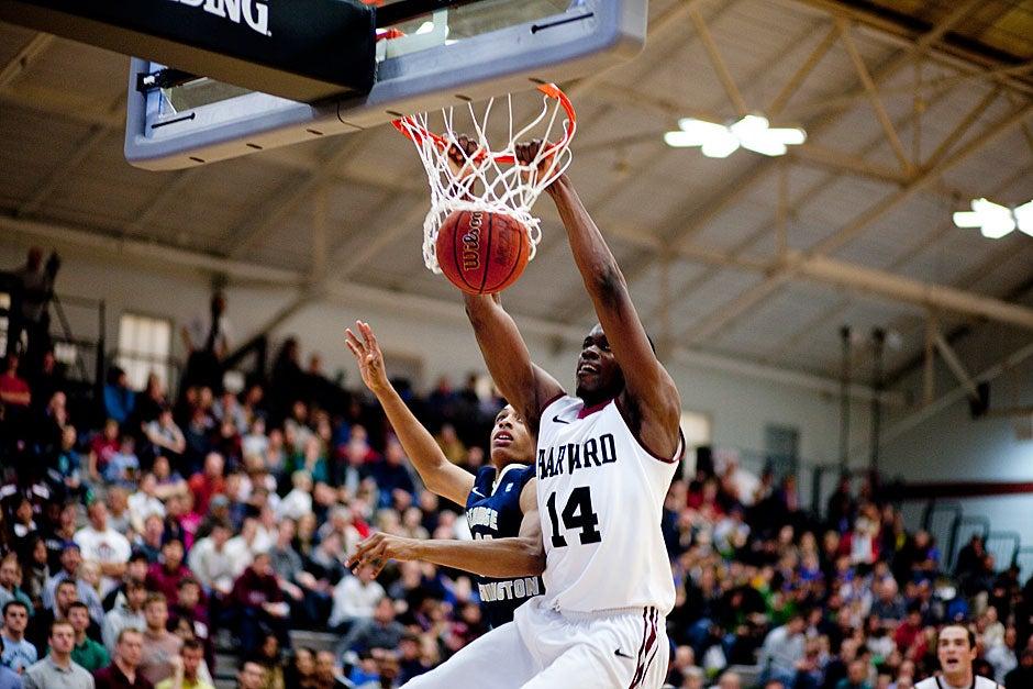 Harvard's Steve Moundou-Missi dunks one, and hangs on. Rose Lincoln/ Harvard Staff Photographer