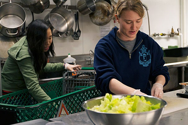 """As a volunteer at the Harvard Square Homeless Shelter, I feel like I'm doing something with a very tangible impact,"" said Janie Tankard '12 (right).  Fellow volunteer Jennifer Soong '14 (left) and Tankard  prepare dinner for their guests."