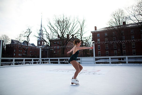 Harvard Graduate School of Design student Trude Renwick breaks in the ice at the opening of Harvard Skate, a free ice skating rink open to the community and located in the plaza adjacent to the Science Center. One of many activities being organized to celebrate the University's anniversary, Harvard Skate is managed under the Common Spaces program.