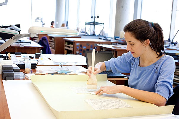 """Conservation intern Allison Holcomb, a master's degree student in the Winterthur/University of Delaware Program in Art Conservation, examined Austen's letters and wrote a detailed """"proposal record"""" for repairing each. It's a technical job, but a private thrill, said Holcomb. She emailed a friend about the project, filling in the subject line with exclamation points."""