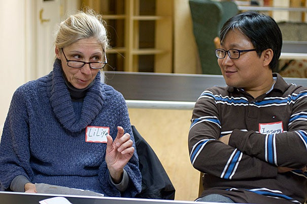 Harvard Neighbors members Liliya Gozdadze (left) of Russia and Insung Hwang (right) of South Korea participate in a weekly English language conversation group to get to know other members of the Harvard community while practicing English skills.