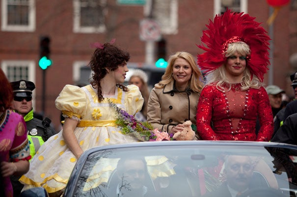 Members of Hasty Pudding Theatricals, dressed in drag, escort 2012 Woman of the Year Claire Danes in the traditional parade down Massachusetts Avenue.