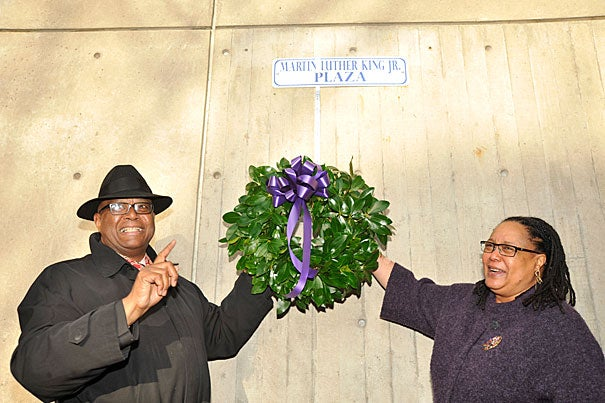 """Acting Cambridge Mayor Kenneth E. Reeves (left) and Harvard College Dean Evelynn M. Hammonds lay a wreath to commemorate Martin Luther King Jr. Day at the Cambridge Public Library. In her keynote address, Hammonds called for educators to help students """"make explicit their own values and build their own 'beloved communities.' """""""