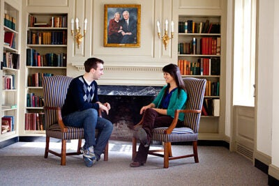 "Pforzheimer House residents Suzanna Bobadilla (right) and Matt Chuchul are the primary student organizers of a one-night exhibit on Harvard's ""great co-educational experiment"" called ""The Residential Revolution: The History of Gender and Pfoho Student Life,"" an exhibit and celebration of House history held in Holmes Hall on Feb. 15."