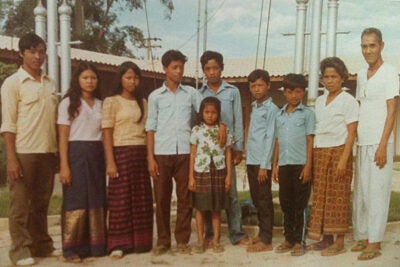 """From a Thai refugee camp, Aun Em's family was brought in 1982 to New York state under church sponsorships. """"It was challenging for us, but we knew we were not in fear of being taken away,"""" Em said (little girl, front). """"We were happy to be in America. We needed to learn how to adapt."""""""