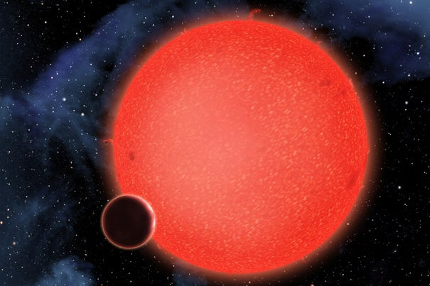 GJ1214b, shown in this artist's conception, is a super-Earth orbiting a red dwarf star 40 light-years from Earth. New observations from NASA's Hubble Space Telescope show that it is a water world enshrouded by a thick, steamy atmosphere. GJ1214b therefore represents a new type of world, like nothing seen in our solar system or any other planetary system currently known.
