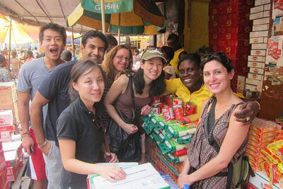A team of first-year M.B.A. students doing fieldwork in a local market in Accra, Ghana.