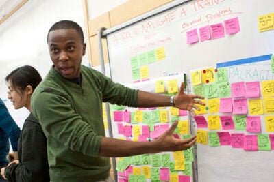 Siyabulela Xuza '12, an engineering sciences concentrator, explains his team's project, a tool kit to ease the transition from high school to college.