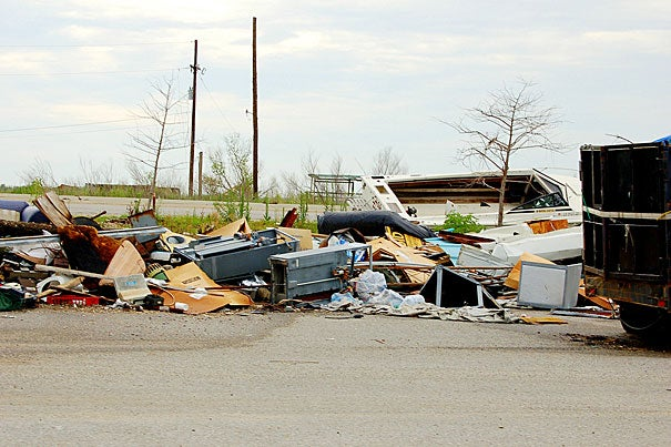 Debris lingered just outside New Orleans in July 2006, almost a full year after Hurricane Katrina devastated the region.