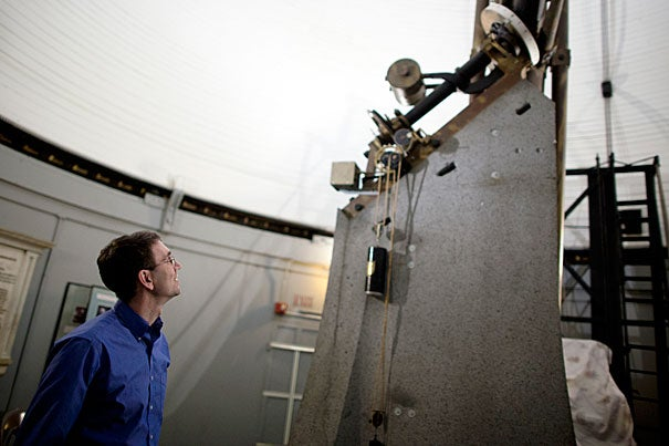 Astronomy Professor Daniel Eisenstein has devised a new method to determine the position of galaxies and is using that to understand how the universe works. Here, Eisenstein looks at Harvard's Great Refractor, installed in 1847 and for 20 years the largest telescope in the country.