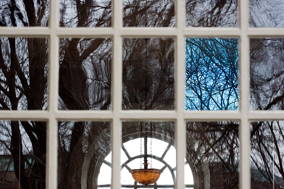 A tinted pane of glass reflects an overcast day at Memorial Church. Kris Snibbe/Harvard Staff Photographer