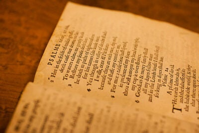 "Houghton Library houses a selection of old books, almanacs, and broadsides from Harvard's first printing press (1638-1692). ""The 'Bay Psalm Book' is in a lot better shape than the paperback you bought 10 years ago,"" said rare books expert Hope Mayo, the Houghton Library's Hofer Curator of Printing and Graphic Arts. (Harvard owns one of the 12 extant copies, one of which is seen here.)"