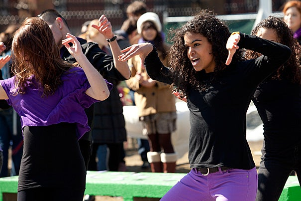 """In recognition of Women's Week, Nina Yancy '13 (right) joined fellow dancers in front of the Science Center at Harvard. """"Our goal is to bring new faces to Women's Week, forge new connections, and inspire students to focus on prevailing gender issues,"""" said event organizer Angela Frankel '14."""