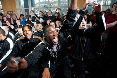 The Harvard men's basketball team watches the selection announcement for the NCAA Tournament at the Murr Center. Harvard was seeded 12th in the East tournament bracket, and will play Vanderbilt in Albuquerque, N.M., on Thursday.